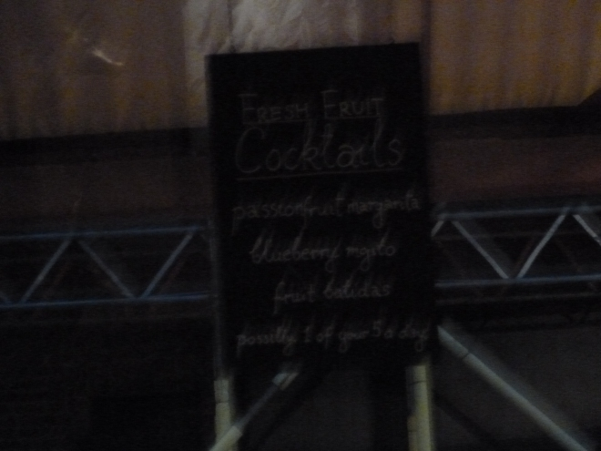 """This sign is hard to read, but it lists fruit cocktails that this particular pub sold, and at the bottom says """"possibly one of your five a day"""". I love the sense of humour some of these places have in England."""
